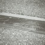 Rain falling on concrete road (2014-07)
