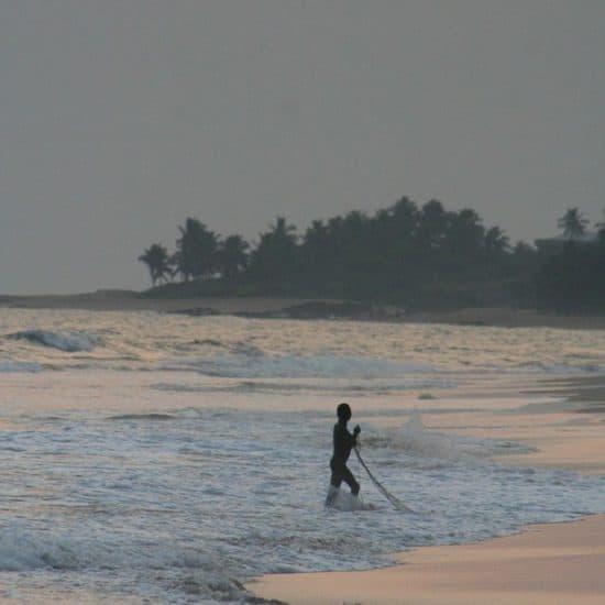 Fisherman in the water at sunset in Brenu Beach, Ghana (2011-12)