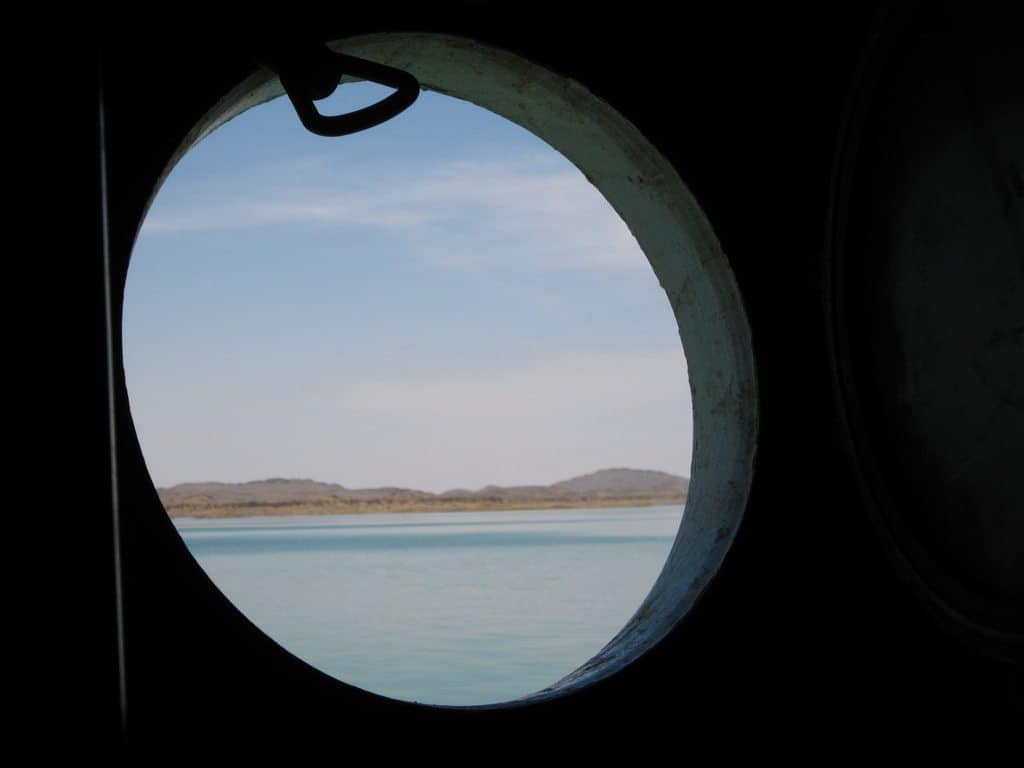 Looking out of the boat window while crossing Lake Aswan from Sudan to Egypt (2012-07)
