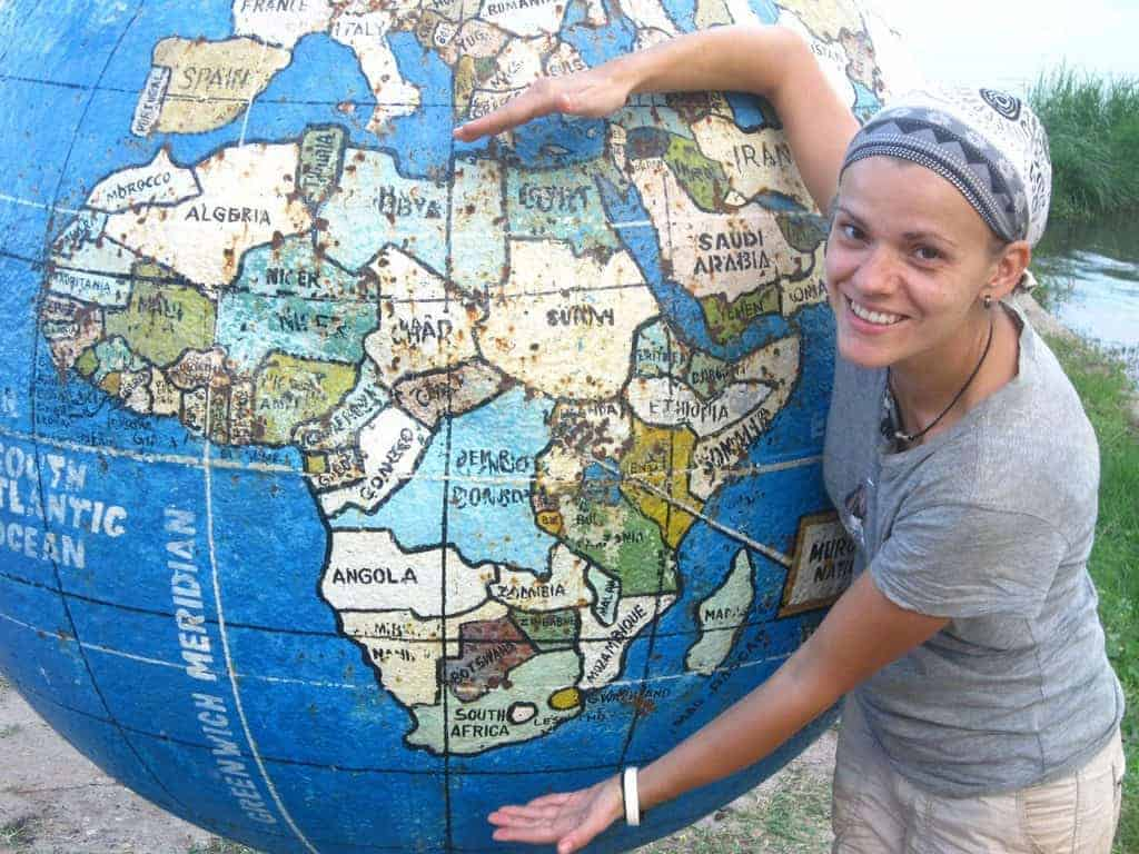 Carola and Africa on a globe, Murchison Falls National Park, Uganda (2012-05)