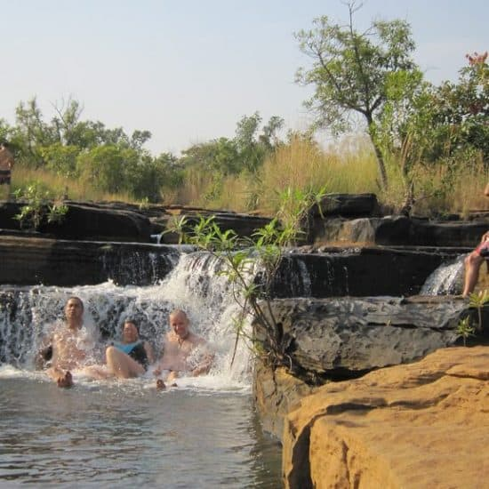 African Trails group bathing in Karfiguela Falls, Burkina Faso (2011-12)