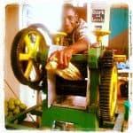 Man making sugar cane juice with a big machine, Mombasa, Kenya (2012-05)