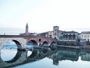 Almost perfect reflection of Ponte Pietra bridge, Verona, Italy (2016-01-20)