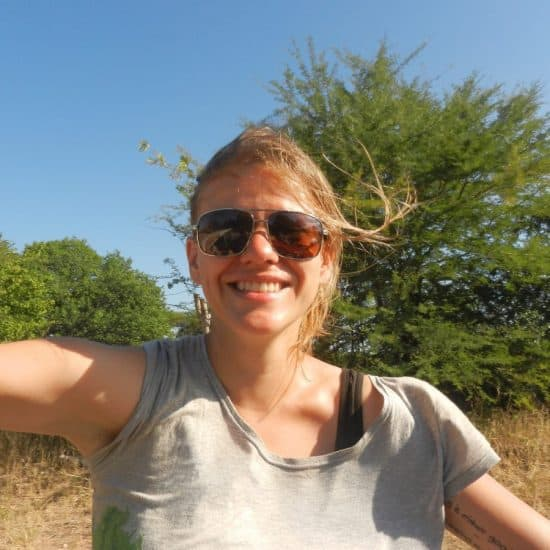 Carola hitchhiking near Lake Kariba in Zimbabwe (2012-04-10)