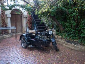 Vintage motorcycle outside Al-Pasha Turkish bath, Amman, Jordan (2016-12-19)