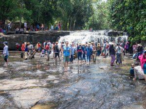 Carola and a waterfall, Kulen National Park, Siem Reap, Cambodia (2017-04-12)