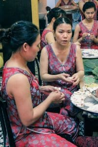 Ladies making White Rose on Hoi An food tour