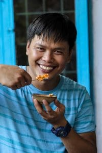 Thin eating Banh Beo on Hoi An food tour