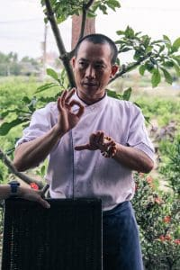 The owner/chef at Cumquat explains Three Friends on Hoi An food tour