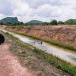 Channel and snail collectors en route to Phnom Chhngok Cave Temple, Kampot, Cambodia (2017-04-29)