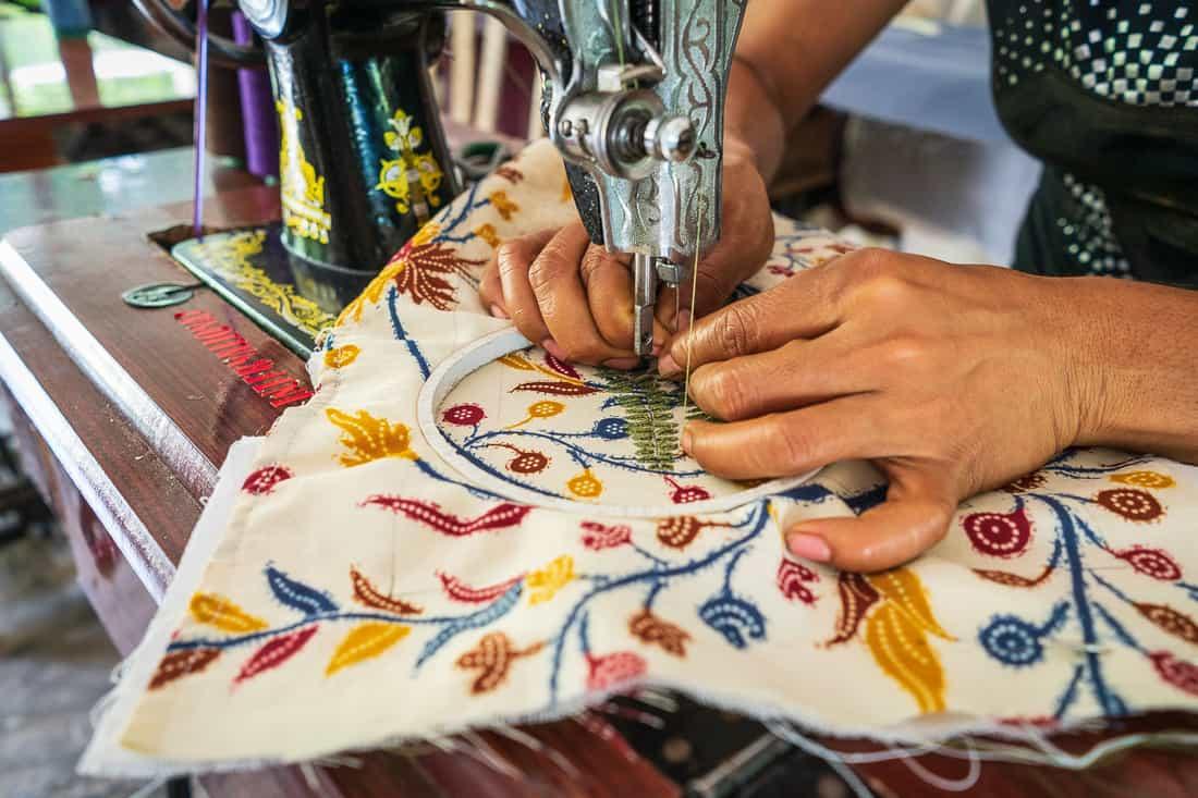 Sewing fabrics at Boneca de Ataúro, Vila, East Timor