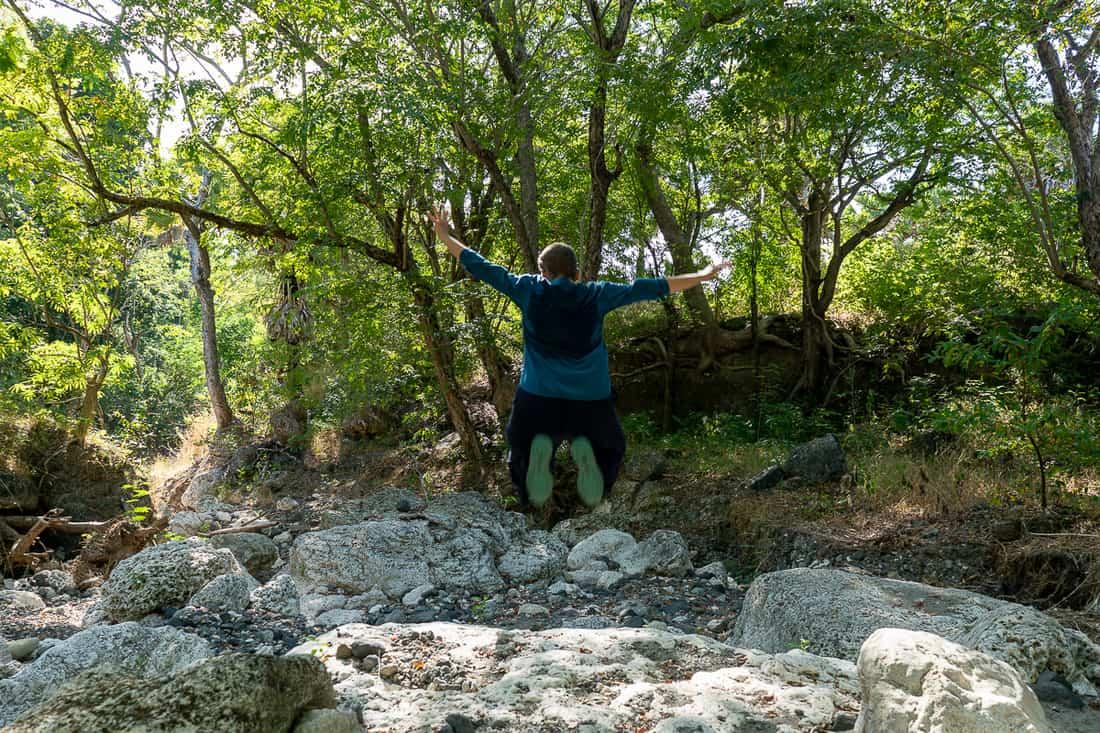 Carola jumps while hiking on Atauro, East Timor