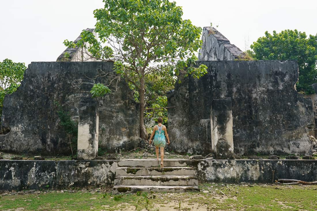 Carola at abandoned Portuguese mansion, Com, East Timor