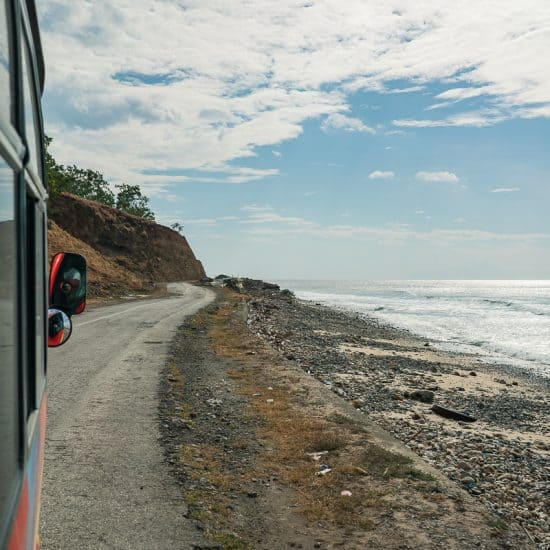Bus on the road along the beach to Baucau, East Timor
