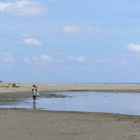 Fisherman at the beach, Suai, East Timor