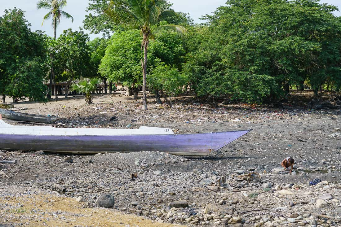 Boat and child at Suai Loro village, East Timor