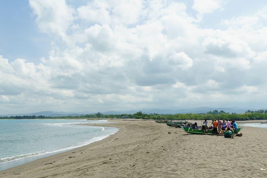 Fishermen selling their catch on Suai beach, East Timor