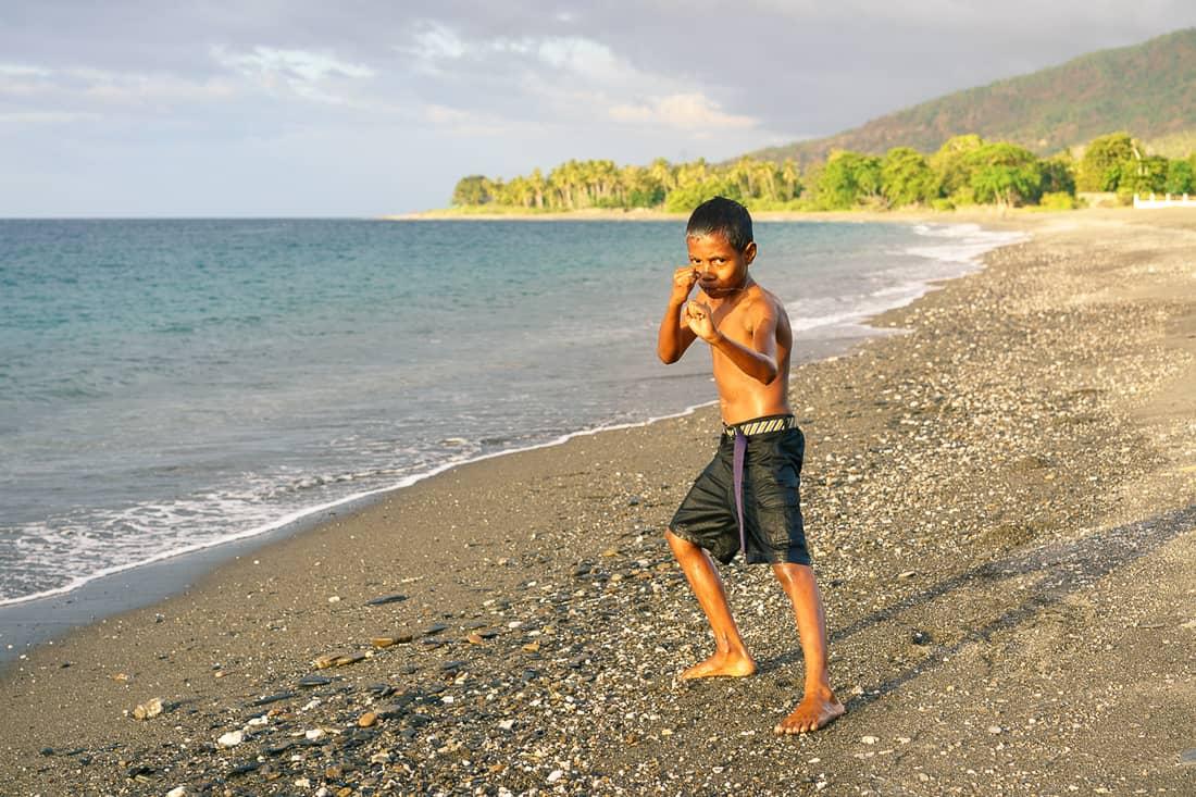 Boy at sunset on Liquica's Lauhata beach, East Timor