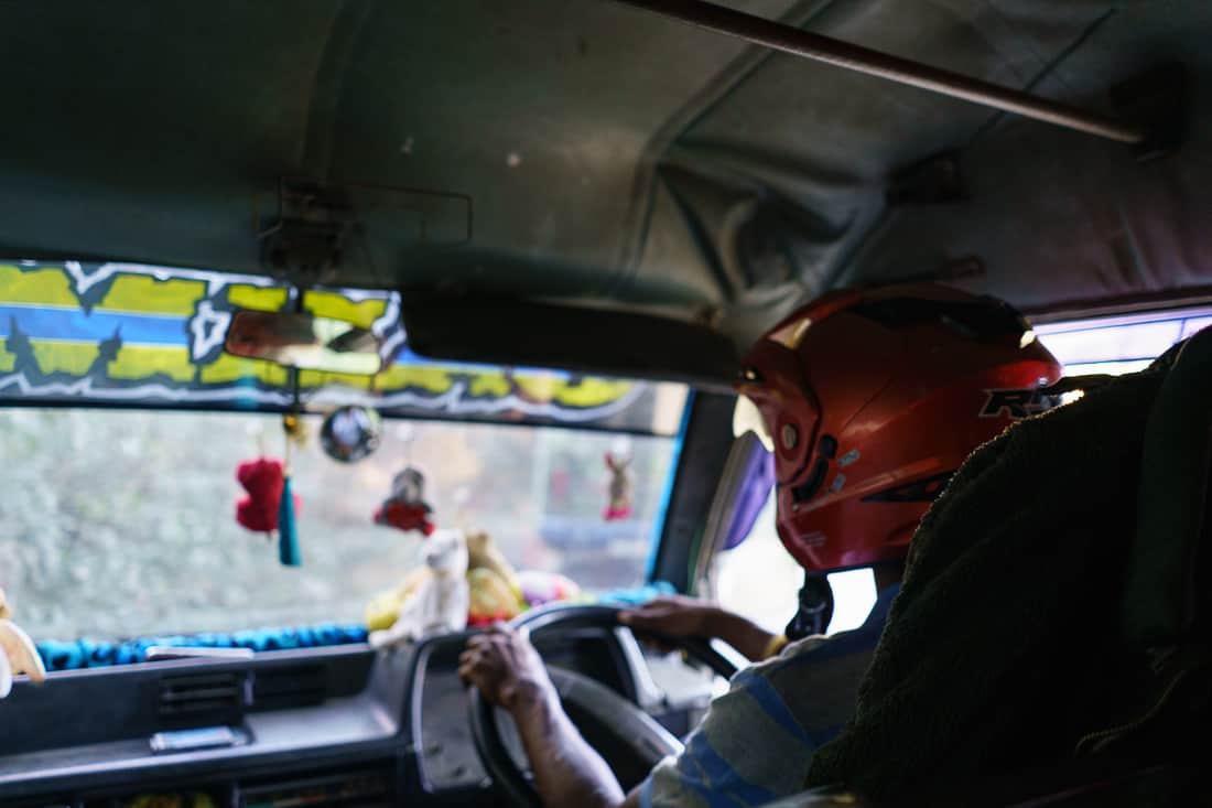 Bus driver with helmet going from Gleno to Letefoho, East Timor