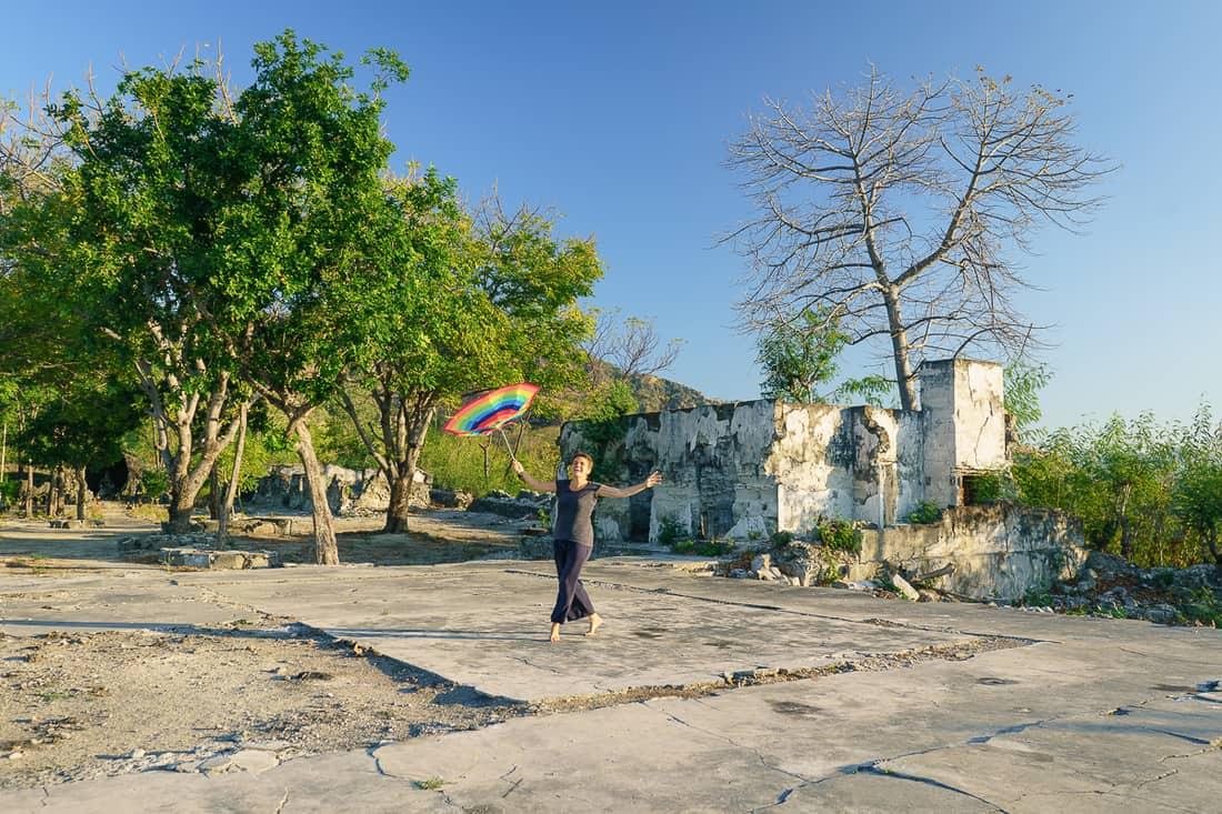 Carola with an umbrella at Faot Sub prison ruin, Pante Macassar, Oecusse, East Timor